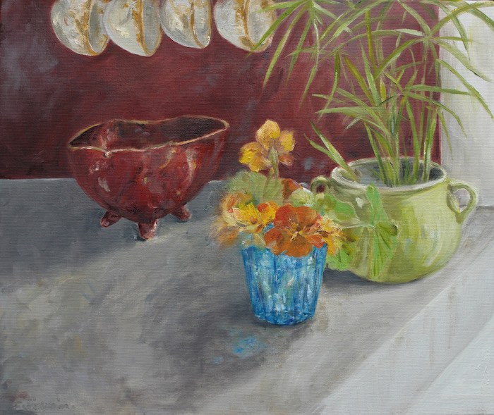 Still life in a kitchen with nasturtiums in a turquoise glass, with plant and red pottery behind a red wall. oil on canvas. sold