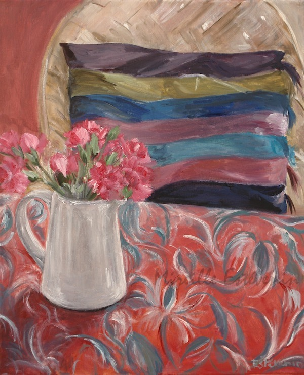 Interior scene with pink carnations in a white pot on a red and blue cloth, and a cushion with colours stripes on an armchair.