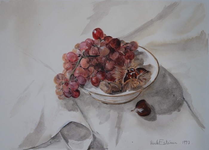 Still life with autumn fruit (grappes, walnuts, chestnuts) in a white dish on a white table cloth. tempera painting on paper.