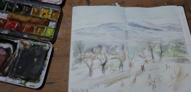 Sketch of landscape with the Ventoux in winter, with cherries trees on the first plan. watercolor, black pen on a leporello sketchbook