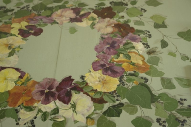 Garland of pansies and insects painted on wood table. acrylic technic