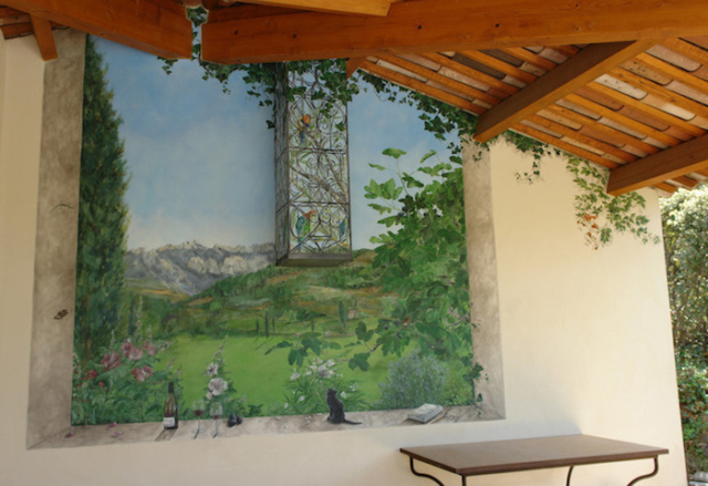 Landscape painted in trompe-l'oeil on the outside wall,protected by a roof. acrylic technic