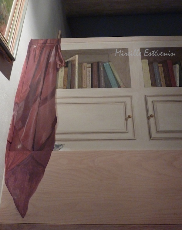 Fake books in a cupboard painted on a wood panel in the stairs. acrylic on wood