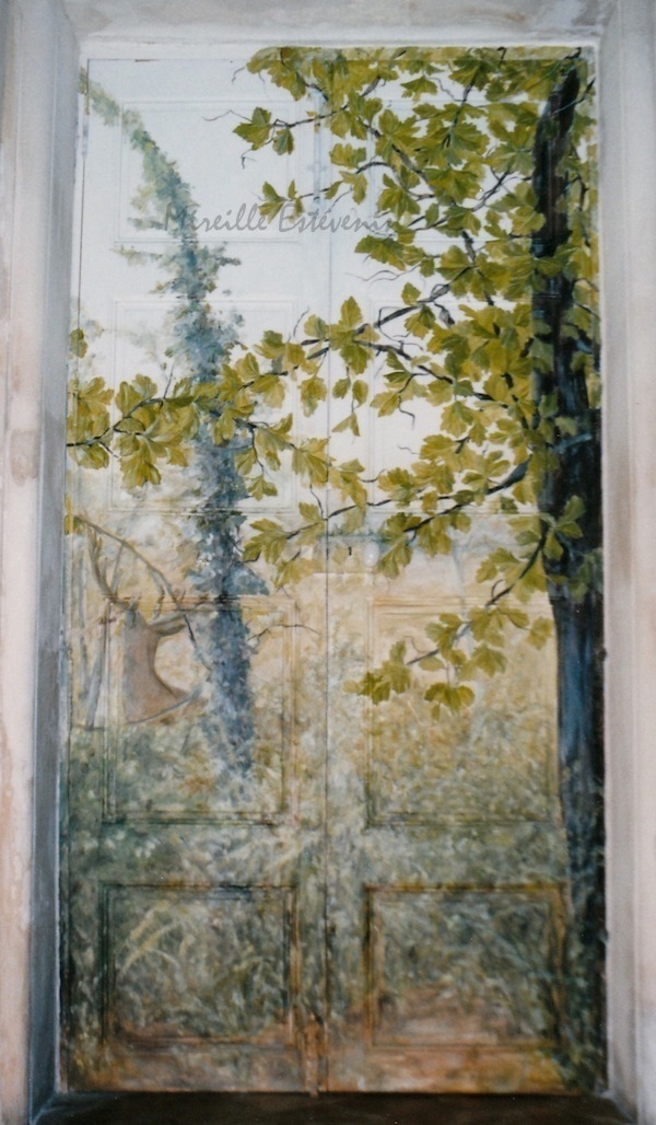 Décor of forest and animals painted on ancient wood door (with panels) in the dining room. Oil paintings