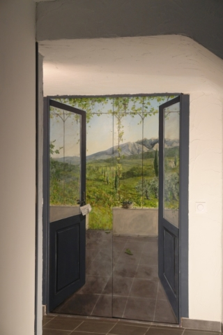 Trompe-l'oeil mural painted on 2 wood doors in the back of the restaurant room. 2 doors opening on a landscape of Provence.acrylic technic