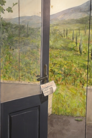 Detail of the door painted on wood door, with a piece of landscape. acrylic technic