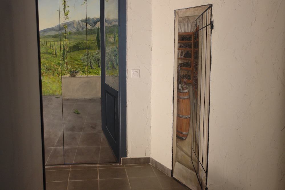 View of the 2 doors in the back of the restaurant room, one with landscape and the second with a wine cellar. acrylic technic