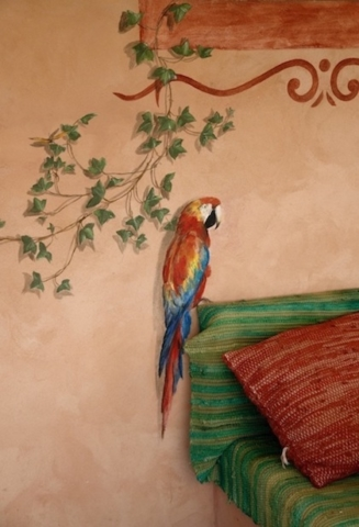 Detail of a parrot painted on the wall of the Mexican mural. acrylic technic
