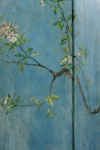 Detail of a branch of apple tree blossom painted on the recto side of the screen. mixed media on wood