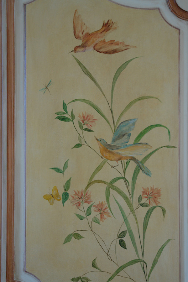 Detail of the décor painted on a door with birds and flowers , in the entrance of the castle. mixed media on wood