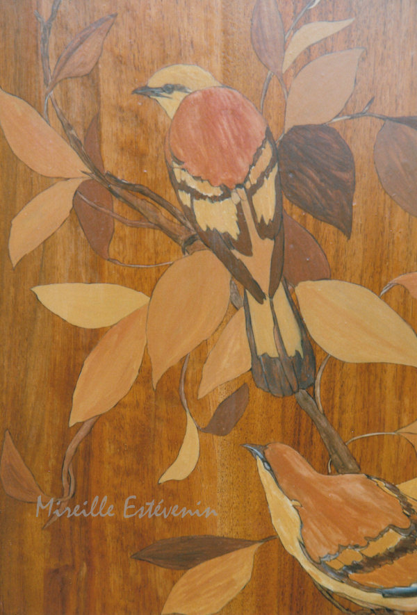 Fake marquetry with birds painted on wood doors with oil paintings
