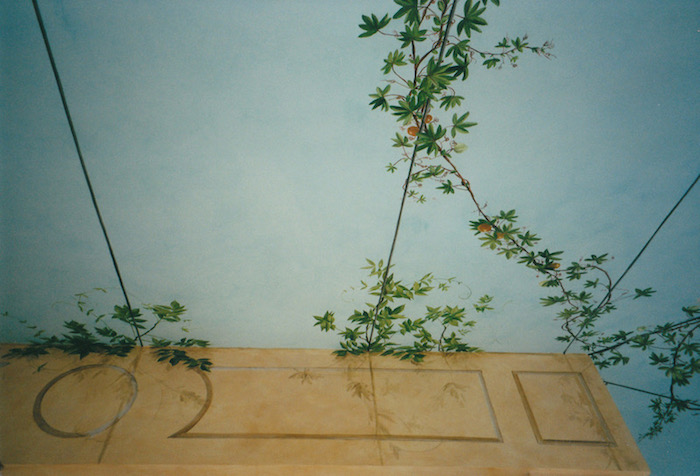 Fake sky and vegetation painted on the ceiling and the walls of a veranda. mixed media
