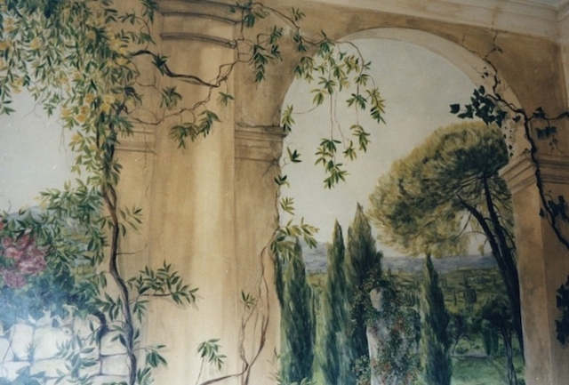 fake architecture with Italian garden painted on a wall of a bathroom. mixed media