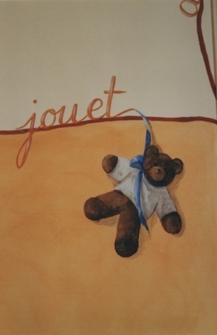 "Detail of a Teddy bear illustrated the word ""toy"" painted on the wall of Marie's bedroom, above the orange color. acrylic painting"