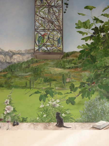 Detail of the mural painted on the outside wall, with a kitten looking a butterfly on the plants. acrylic technic