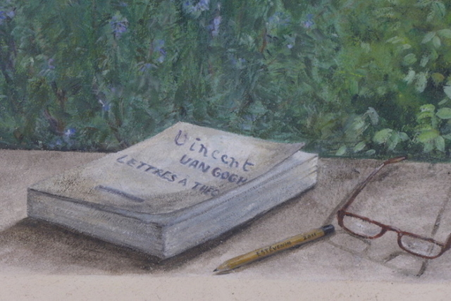 Detail of the décor trompe-l'oeil painted on an exterior wall, with the letters book of Van Gogh, glasses and a pen