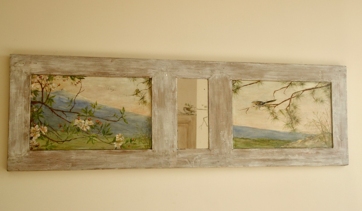 Landscape painting on 2 wood panels fixed on an ancient shutter. In the middle a little mirror reflects the birds bedrooms. mixed media on wood.