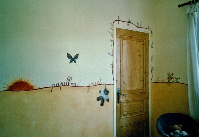 Frieze with words illustrated , painted on the walls of Marie's bedroom, above the orange color