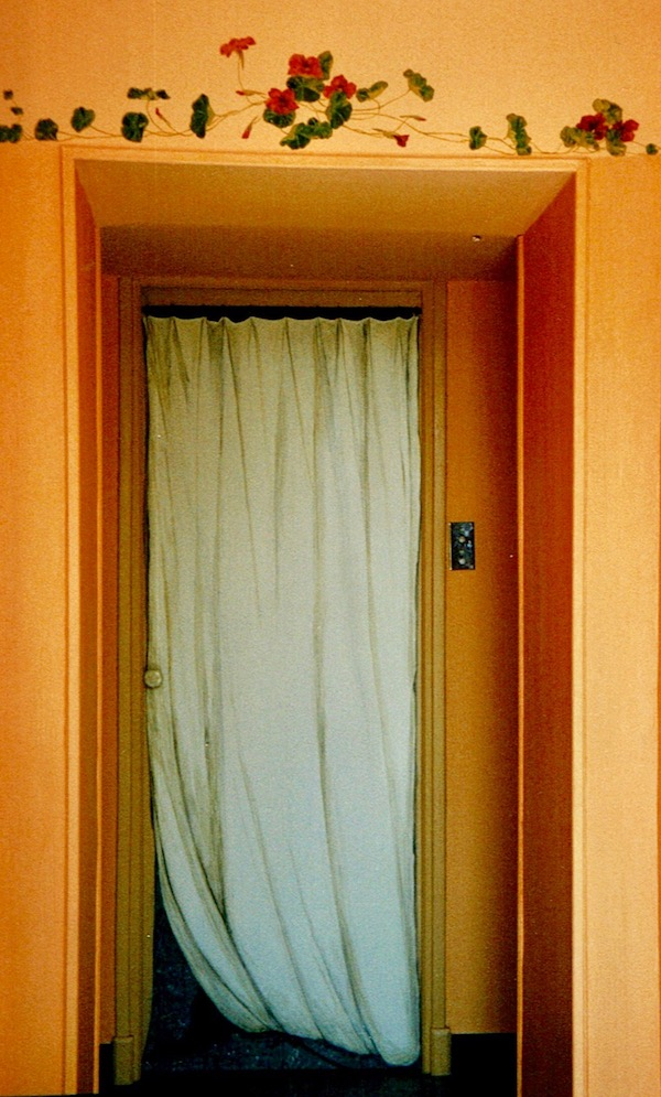 Trompe-l'oeil mural painted on a wood door with a white curtain. acrylic technic on wood