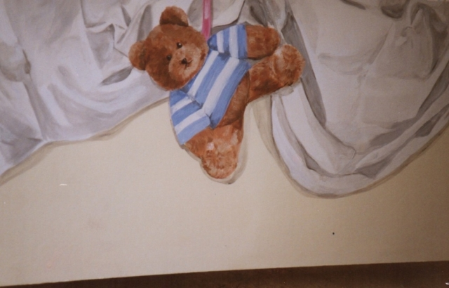 Teddy bear and sheet painted on a side of a wood bed with acrylic colors.
