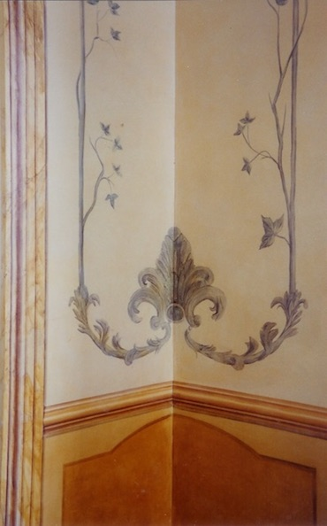 Detail of the Louis XV dining room, in blue and ochre colors, with fake mouldings  and foliage. décor painted with oil paintings