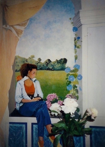 Mural painted on a wall in my  mum's house, with a women setting with a black and white cat. acrylic technic