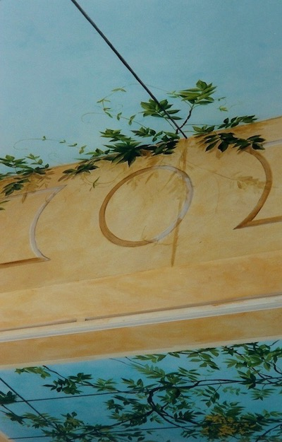 Detail of the trompe-l'oeil mural painted on the ceiling of the veranda. mixed media