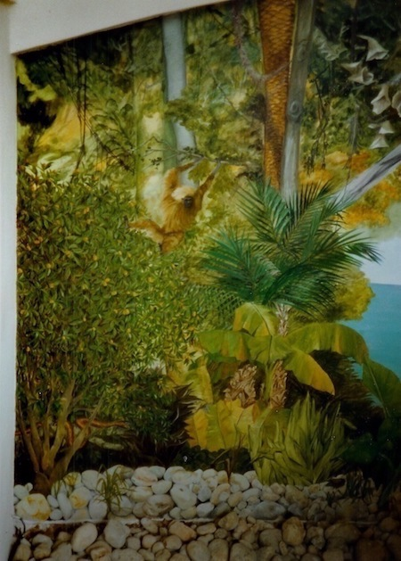 trompe-l'oeil mural painted on a wall of the entrance of the house. Exotic jungle with animals. mixed media