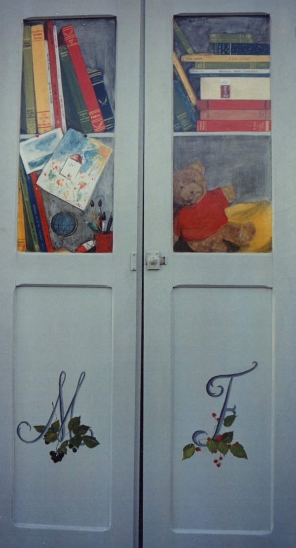 Fake  library for children books and toys painted on the 2 doors of the cupboard of Marion. mixed media on wood