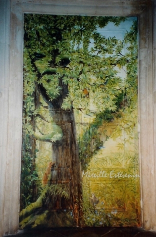 Big trees and animals painted on an ancient wood door (with panels) in the dining room. Oil paintings technic