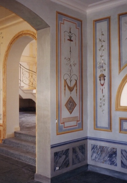 The entrance and a room with ancient décors and fake  blue marble painted on walls and ceiling of a House in the Parcs of St Tropez