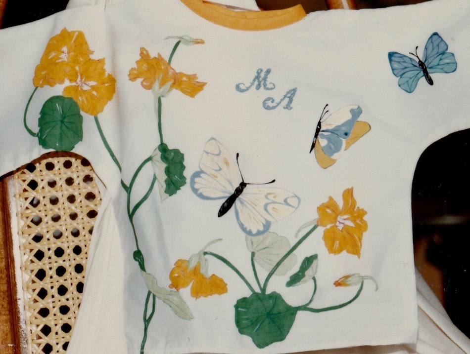 Initials , butterflies and yellow flowers painted on a cotton baby cloth, with cloth paintings.
