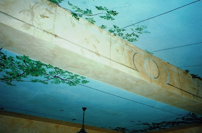 Detail of the ceiling painted in a veranda  with sky. acrylic media
